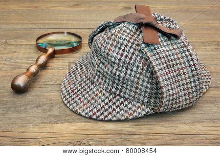 Deerstalker Hat And Retro Magnifying Glass