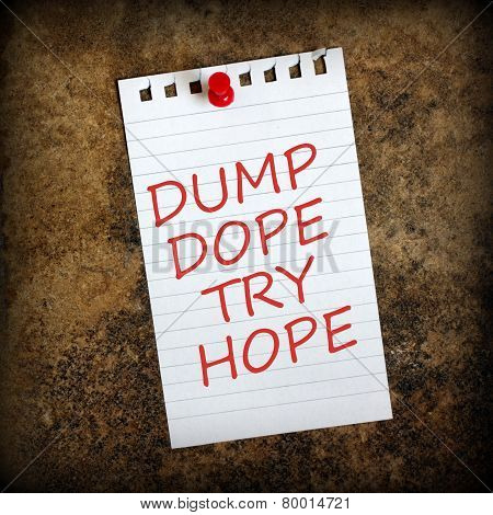 The phrase Dump Dope, Try Hope on a lined paper note pinned to a gunge background. Image has been enhanced with a vignette for effect. poster