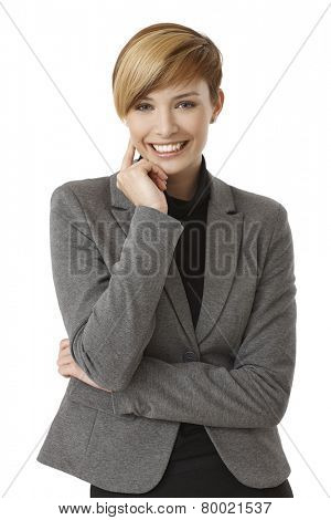 Portrait of happy young businesswoman thinking, smiling. Isolated on white.