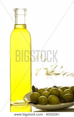bottle of olive oil with olives