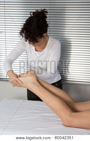 Foot Massage. Female Hands Giving Massage To Soft Bare Foot
