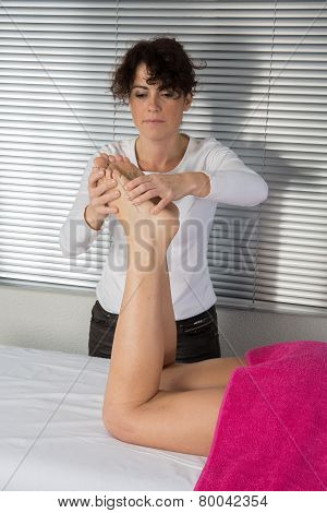 Female Hands Giving Foot Massage To Soft Bare Foot