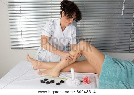 Young Woman Having Stone Massage In Spa Salon. Healthy Lifestyle