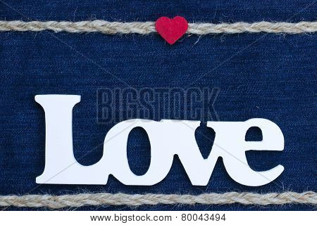 Love text with red heart and rope border on denim