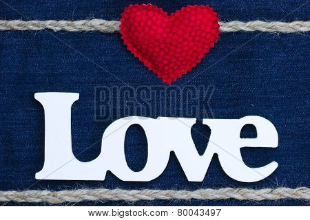 Love text with red heat and rope border on denim