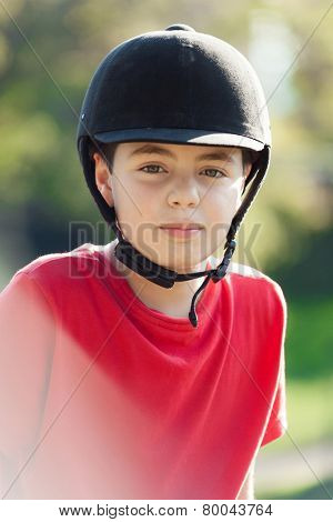 little boy riding a horse in the woods, portrait