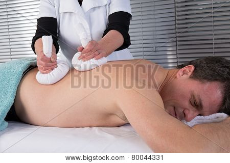 Man Getting Thai Massage In The Beauty Salon