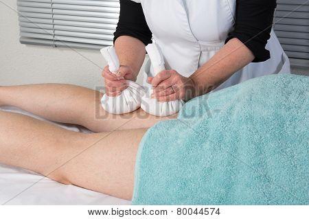 Man Having Ayurveda Massage With Herbal Ball.