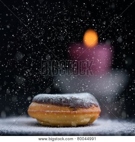Romantic Winter Decoration With Donut And Candle