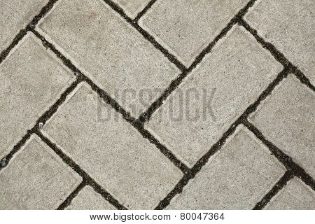 Concrete block pavement laid as parquet. Background texture.