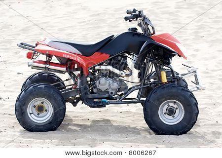 Quadricycle In The Sand