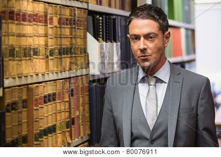 Lawyer looking at camera in the law library at the university