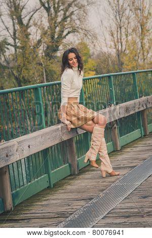 Beautiful Young Woman Posing On A Bridge