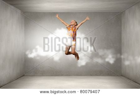 Little cute girl jumping high and flying in sky
