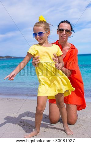 Adorable little girl and young mom during summer vacation