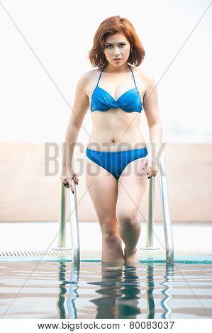Asia Bikini Sexy Woman Resting On Stair Of Swimming Pool