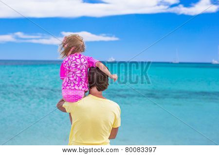 Young father and little daughter have fun during tropical beach vacation