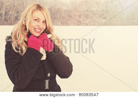 Happy Woman In Snow Looking Up At Camera, Copy Space
