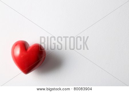 Beautiful decorative heart on white paper background, close-up