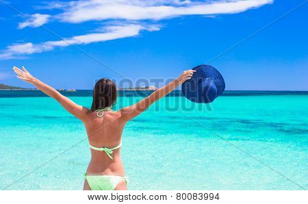 Happy young girl enjoy tropical beach vacation