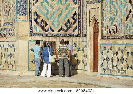 People explore mausoleum of Khoja Ahmed Yasavi in Turkistan, Kazakhstan.