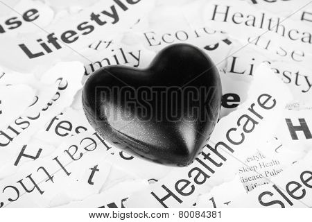 Decorative heart on background of paper notes