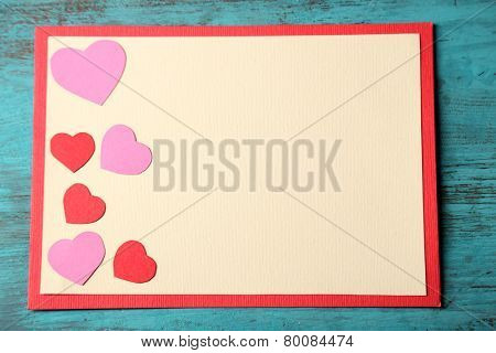 Beautiful hand made post card on color wooden background
