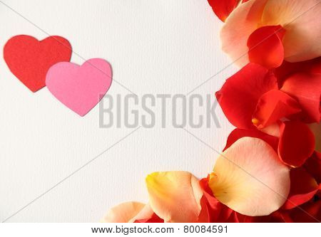 Beautiful hand made post card with hearts and rose petals, close-up
