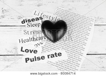 Decorative heart on paper notes, on wooden background