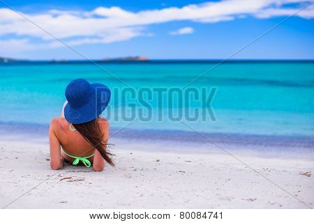 Back view of woman at tropical beach during summer vacation