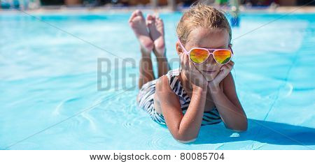 Little girl at aquapark during summer vacation