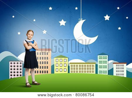 Cute schoolgirl against colorful background with book in hands