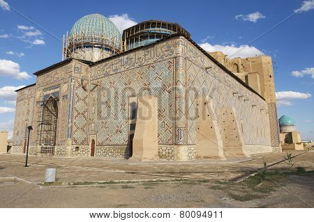 Exterior of the beautiful medieval mausoleum of the famous 12th century poet and sufi Khoja Ahmed Yasavi in Turkistan, Kazakhstan. UNESCO World Heritage site. poster