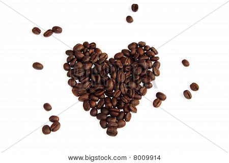 Roasted Whole Coffee Beans Arranged Into A Love Heart