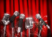 Conference meeting microphones prepared for talker over Red Curtains. poster