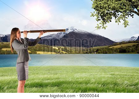 Businesswoman looking through a telescope against scenic backdrop