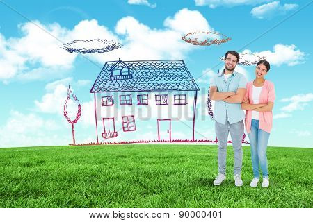 Happy couple with arms crossed against blue sky over green field