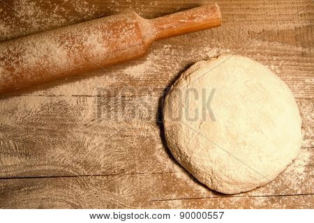 Homemade Baking. Fresh Dough For Pastry, Spilled Flour, Kitchen Rolling Pin On A Chopping Board