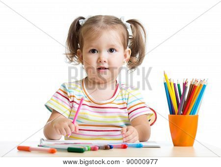 child little girl draws with pencils