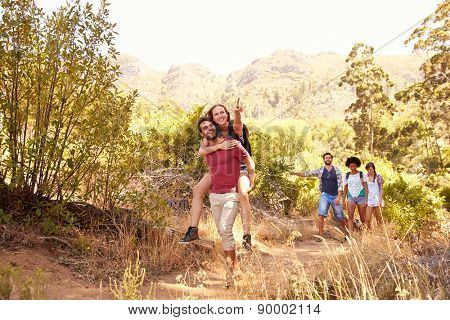 Group Of Friends On Walk Through Countryside Together