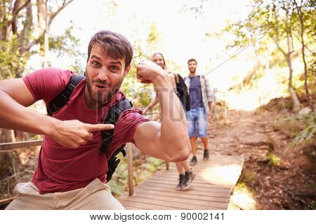 Man On Walk With Friends Making Funny Gesture At Camera