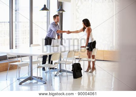 Businessman shaking hands with a job applicant
