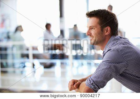 Portrait of man in office, side view