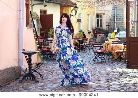 Beautiful Woman In Dress Walking In Old Town Of Tallinn, Estonia