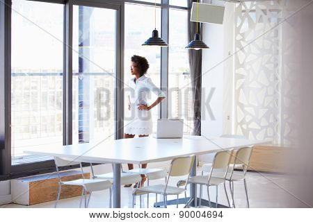 Young woman in empty meeting room