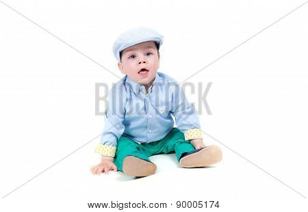 Fashionable little baby. Handsome blond baby with big blue eyes. White background