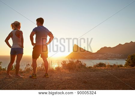 Man and woman talking after jogging