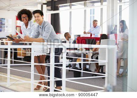 Staff working in a busy office mezzanine