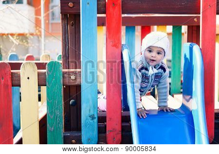 Child at playground. Old Film-look