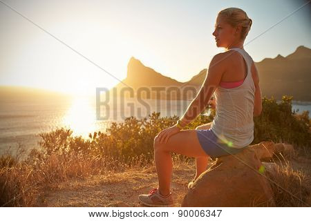 Young woman resting after jogging